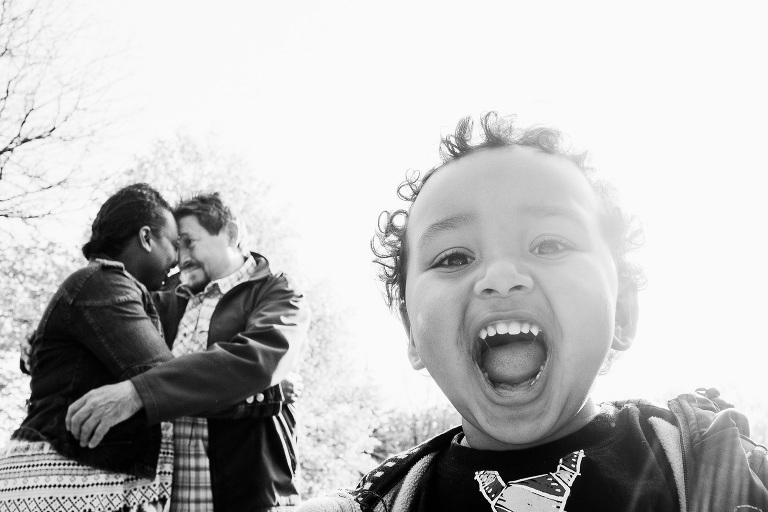 Engagement portrait of a couple with their son.