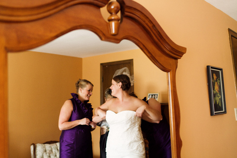 the bride gets dressed with her family in Waterloo, Ontario