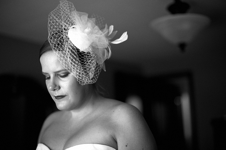 a quiet moment as the bride gets ready as shot by Kitchener wedding photojournalist