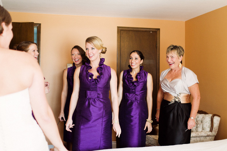 the bridesmaids in awe at the sight of the beautiful bride in Kitchener, Ontario