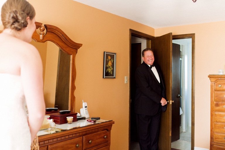 the father of the bride sees his daughter the first time on the morning of her wedding day.
