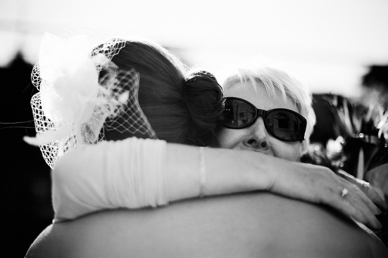 a big hug at a wedding by Kitchener wedding photographer