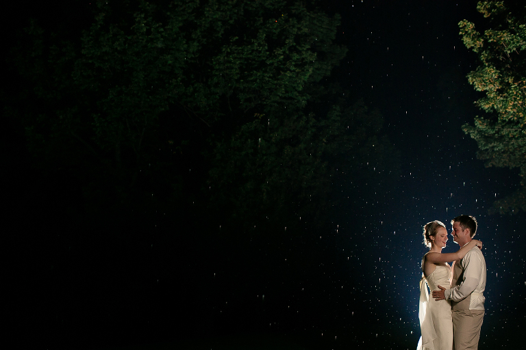 Portrait of a newlywed bride and groom in the rain