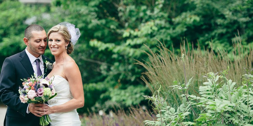 The bride and groom gets photographed by Toronto wedding photographer before their Langdon Hall outdoor wedding ceremony.