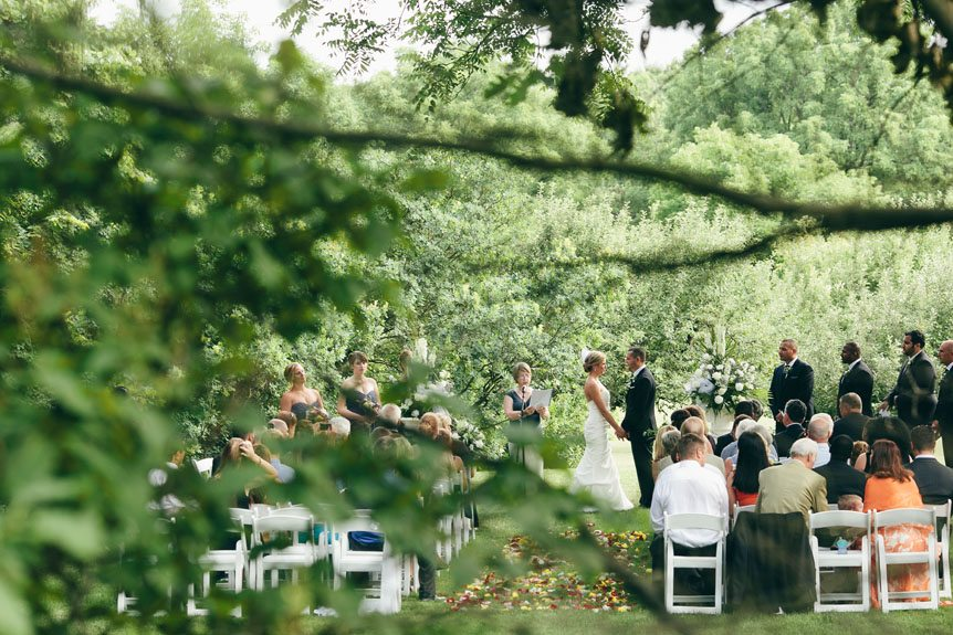 An outdoor wedding ceremony in Langdon Hall by Toronto wedding photographer.