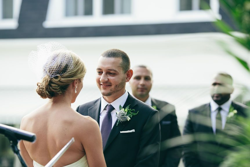 The groom professes his vows at his Langdon Hall outdoor wedding ceremony as captured by Toronto wedding photographer.