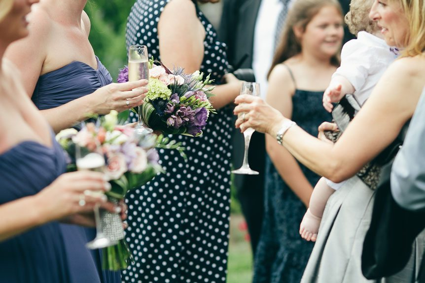 Guests mingle with the bridesmaids at a Langdon Hall wedding as photographed by Toronto wedding photographer.