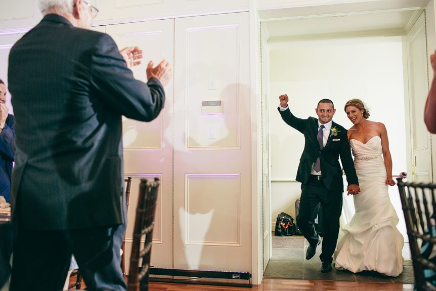 The bride and groom makes an entrance as photographed by Toronto wedding photographer in Langdon Hall.