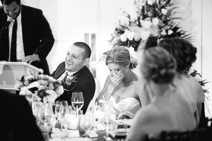 The bride and groom reacts to a funny speech at their Langdon Hall wedding as photographed by Toronto wedding photographer.