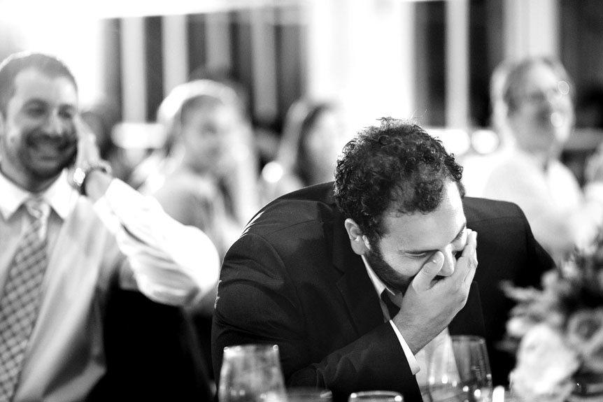 Toronto wedding photographer captures funny candid moments at a Langdon Hall wedding reception.