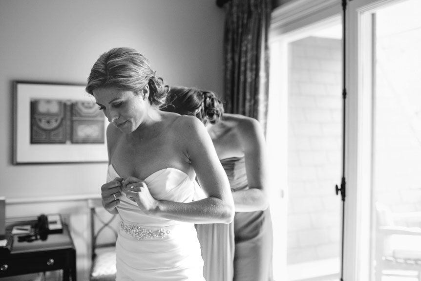 The bride inside the Langdon Hall bridal suite gets her gown on as photographed by Toronto wedding photographer.