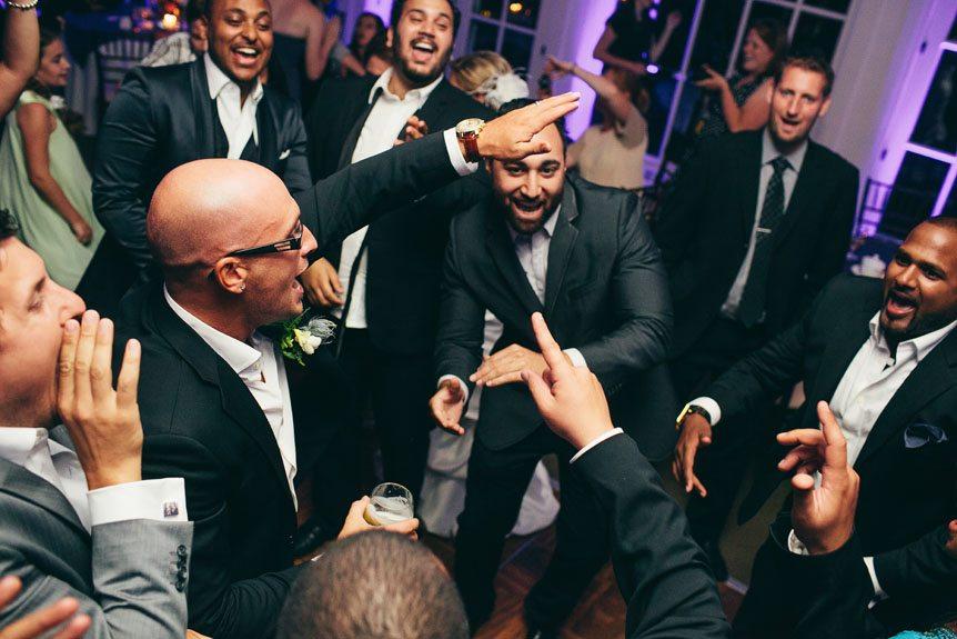 Toronto wedding photographer shoots wedding guests having a blasts at a Langdon Hall wedding.