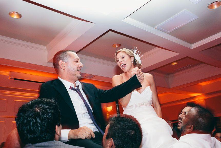 Newlyweds at their wedding reception at Langdon Hall by Toronto wedding photographer.