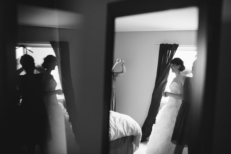 Creative wedding photography technique using reflections as shot by the best Toronto wedding photographer.