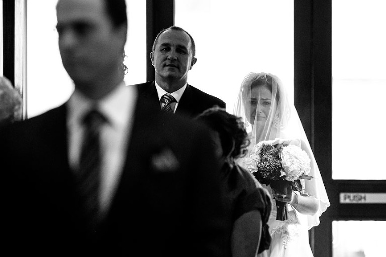 An image of an emotional bride before she walks down the aisle.