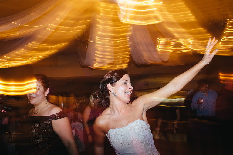 The bride dancing away.