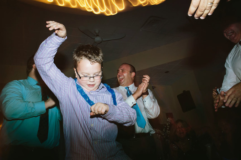 Little boy dancing to Gangnam Style at a wedding reception.