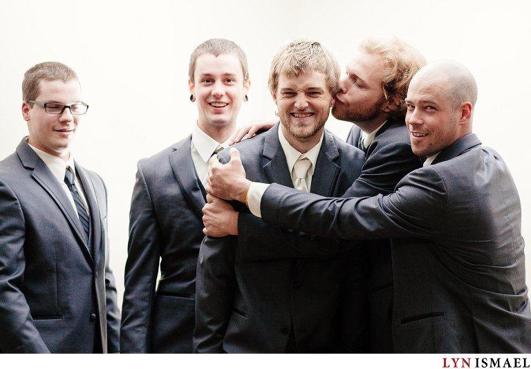 Goofy groomsmen having fun.