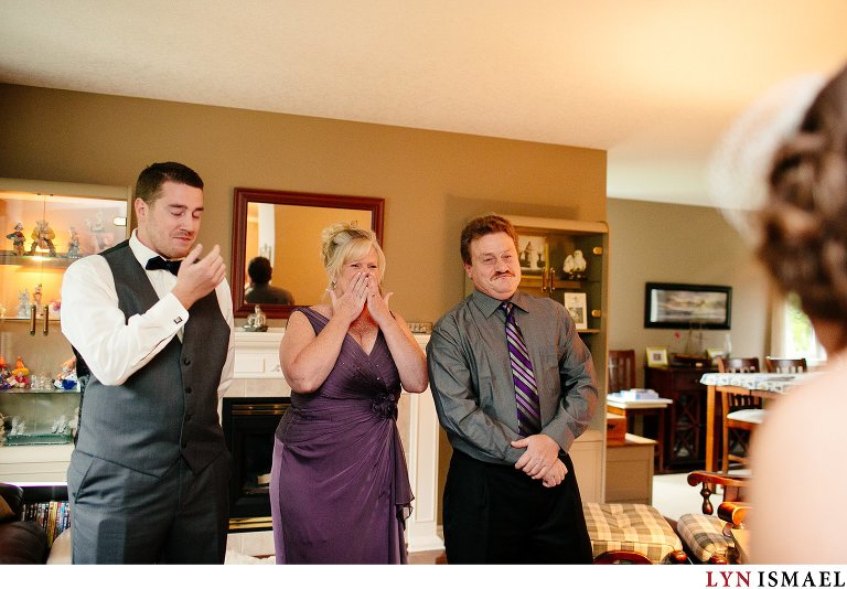 An emotional reaction from the bride's family upon seeing the bride for the first time.