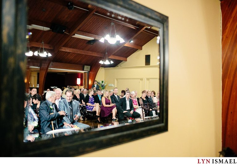 People waiting at an indoor wedding ceremony at the Cutten Fields in Guelph.