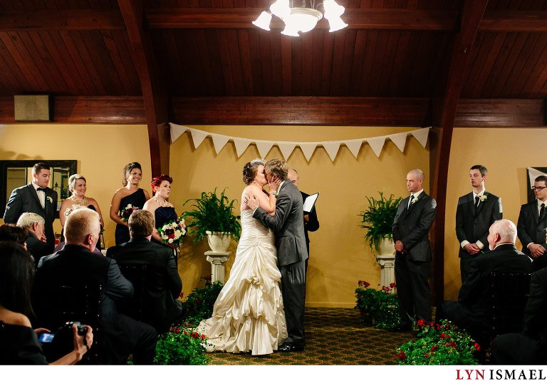 The first kiss at an indoor wedding ceremony at the Cutten Fields in Guelph.