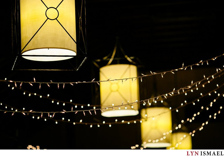 Lanterns and Christmas lights as wedding decor to set the mood at a Cutten Fields wedding.