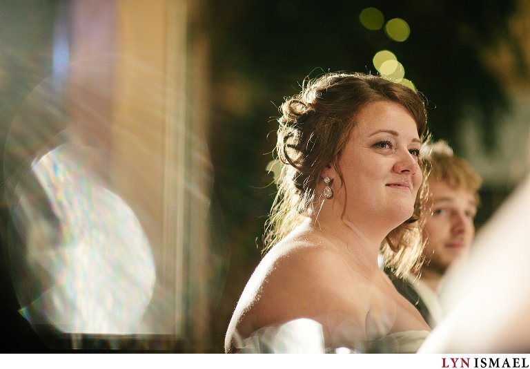 An emotional moment captured of the bride listening to her parent's speech.