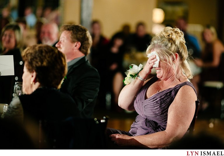 Mother of the bride reacting to her daughter's speech.