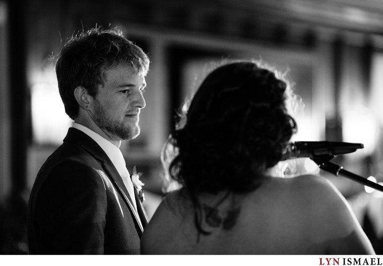 Groom listening to his bride's emotional speech at their Cutten Fields wedding.