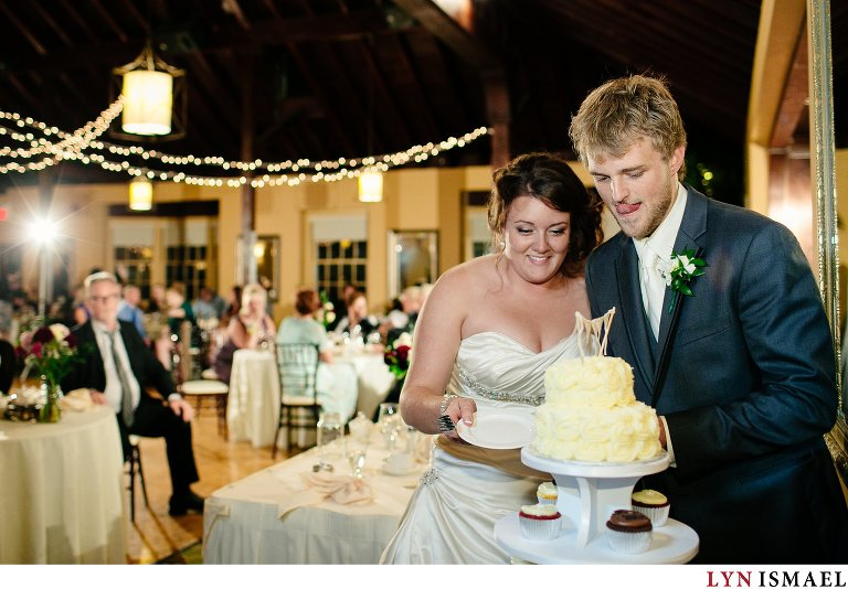 Bride and groom cuts their cake.