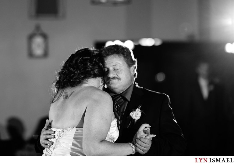 A father of the bride dances with his daughter.