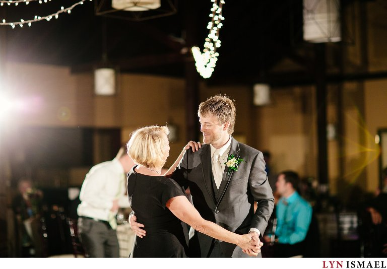 The groom dances with his mom.