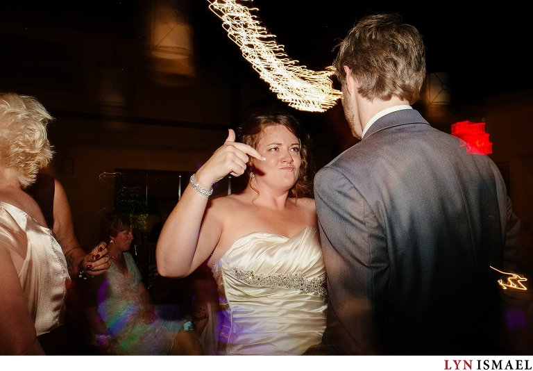 Bride and groom dances to the tunes.