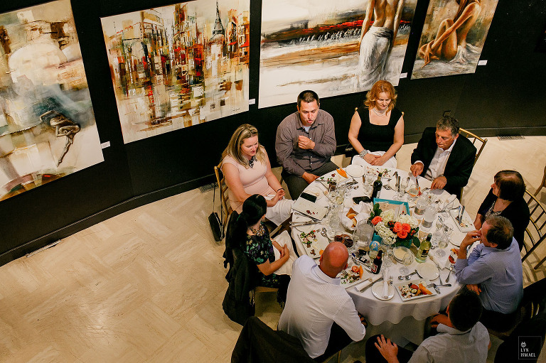 Columbus Event Centre Wedding Reception Guests Eating Dinner Surrounded By Art Works At The Joseph D Carrier Gallery