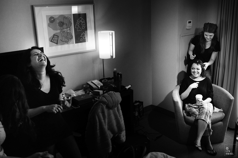 Bride and her friend laughs at the same inside a hotel room at the Novotel Hotel Toronto Centre