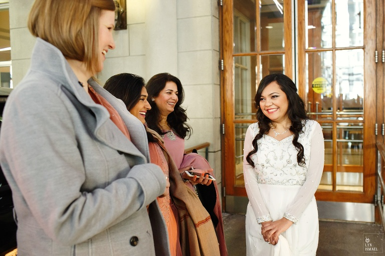 Bride happily talks with her bridesmaids before heading to church