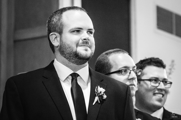Groom watches his bride walk down the aisle at a Kitchener Mennonite Brethren Church wedding.