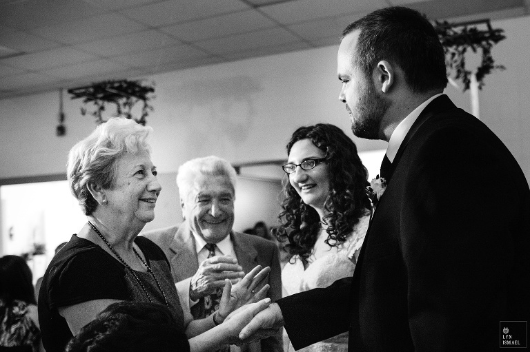 Bride and groom greet their guests at their wedding reception at the Wellesley Community Centre.