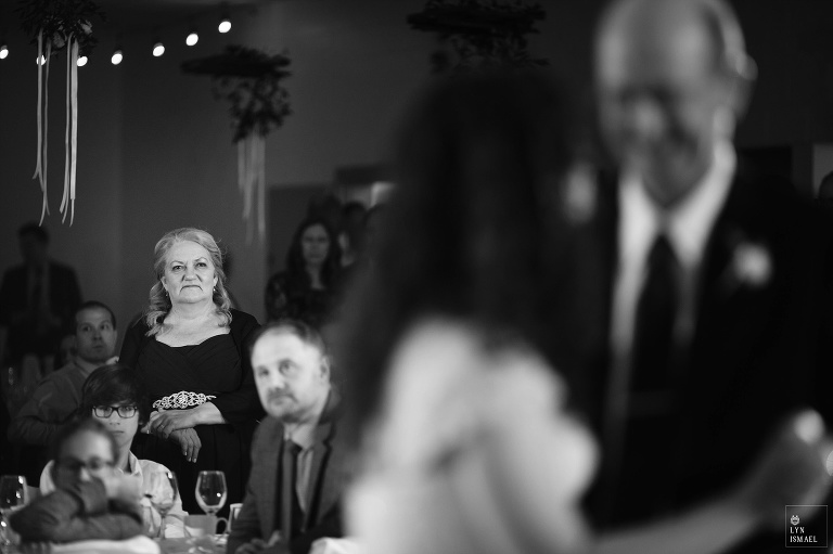 Mother of the bride watches father-daughter dance