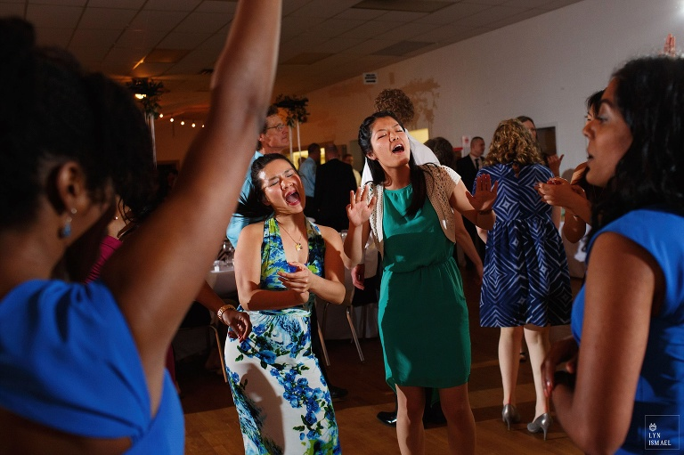 Wedding guests have fun on the dance floor at Wellesley Community Centre